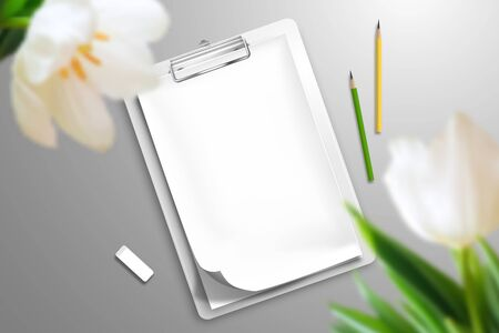 The blank notebook is clamped in the clipboard, two pencils and an eraser that are scattered over the surface. In the foreground are large tulip flowers. Top view mockup template