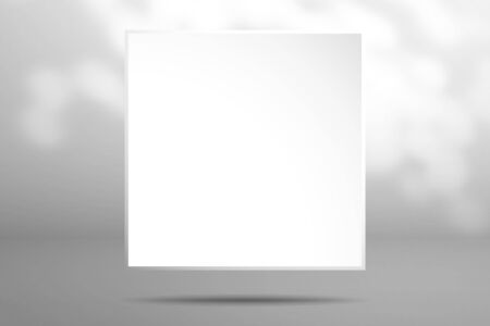 A white blank square sheet of paper is above the surface. Realistic window light and shadow