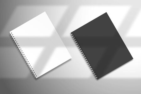 Flat lay with black and white spiral notebooks. Mockup for design with light from a window Illustration