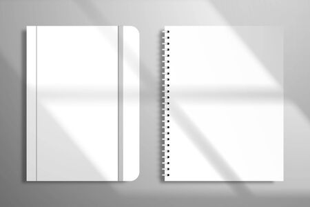 Notebook with a spiral and a notebook with an elastic band. Mockup for design with light from a window