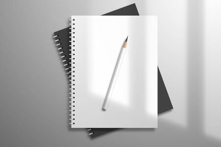 White and black spiral notebooks and pencil is on top. Mockup for design with light from a window 矢量图像