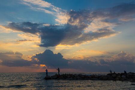 yam israel: fishing at sunset, Israel, Bat Yam Stock Photo