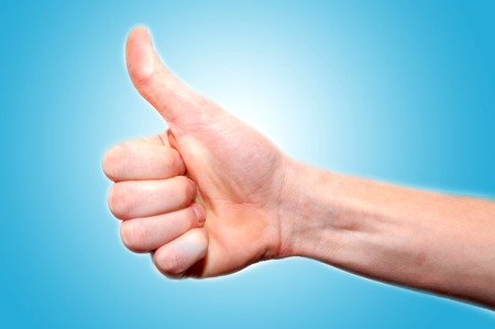 win: Gesturing hands on blue background Stock Photo