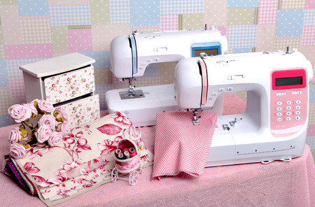 stitchwork: Foto composition of the sewing machine with threads Stock Photo