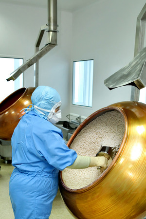 pharmaceutical company: Female pharmacist works in a factory.Production of medicines, pi