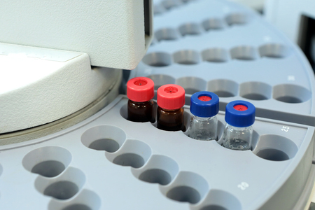 spectrometry: Quality Control Laboratory medicine. Chromatograph operation. Bottles check on the quality of the suspension. Vials on autosampler of gas chromatography-mass spectrophotometer. Ampoules are chemical control suspension in the gas chromatograph. Gas chromat