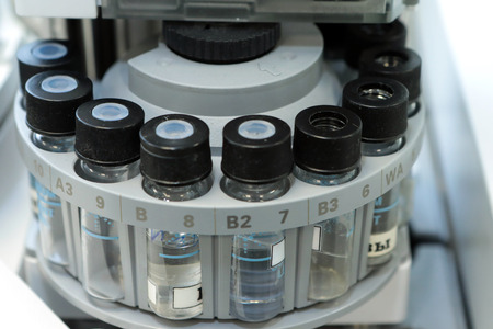 Quality Control Laboratory medicine. Chromatograph operation. Bottles check on the quality of the suspension. Vials on autosampler of gas chromatography-mass spectrophotometer. Ampoules are chemical control suspension in the gas chromatograph. Gas chromat
