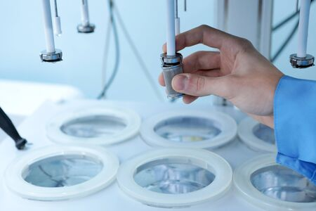 Autonomous solubility tester. Imitation dissolution of the tablet in the human stomach. Scientific research of pharmaceutical laboratory. Man conducts scientific work at the plant. Laboratory research in pharmacy. Erveka in the work. Automatic dissolution systems. Stock Photo