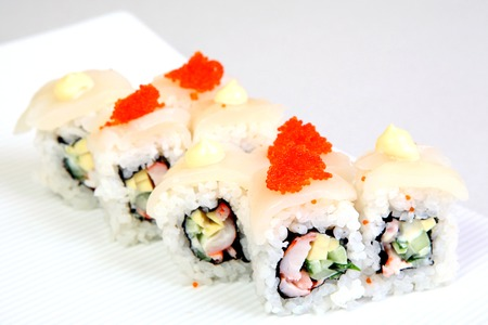 Roll Canada. Uromaki. in the nori. Japanese food on a beautiful dish. Diet food