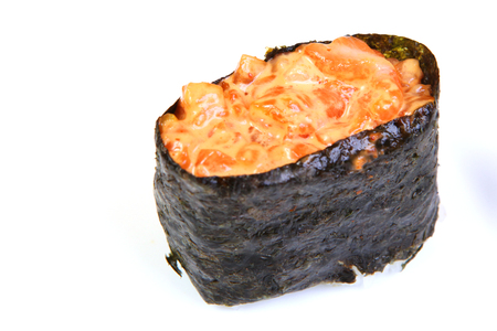 Spice sushi with smoked salmon. In nori seaweed. Japanese food on a beautiful dish. Dietary food. An exquisite Japanese dish. Imagens