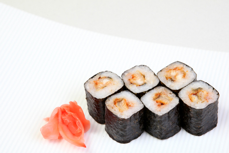 Rolls of Syak maki. Japanese food on a beautiful dish. Dietary food. An exquisite Japanese dish. Imagens