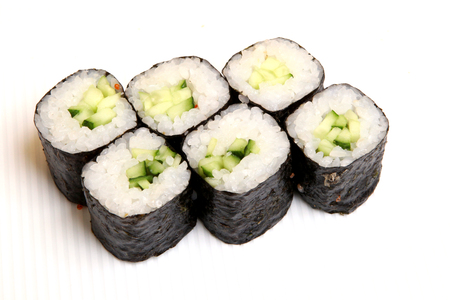 Roll with cucumber. Vegetarian food. Sushi in the nori. Japanese food on a beautiful dish. Diet food.