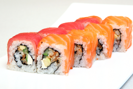 Sushi. Rolls with shrimp. Roll California with avocado. Japanese food. Healthy food is nicely laid out on a platter. Dish with rice. Diet. Reklamní fotografie