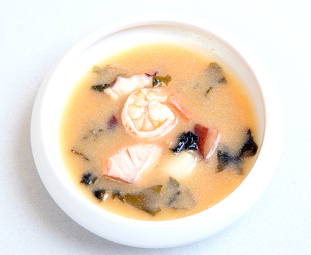 Japanese soup with shrimps. Delicious healthy food for health. Dietary soup with seafood. Soup in a bowl.