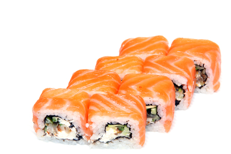 Roll Tokyo. Sushi with salmon, eel, tender cheese. Japanese food on a beautiful dish. Dietary food.