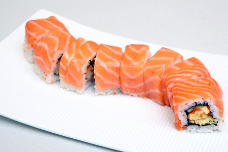 Roll Tokyo. Sushi with salmon, eel, tender cheese. Japanese food on a beautiful dish. Dietary food. Stock Photo - 109004077