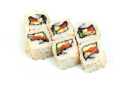 Roll California in sesame. Sushi with crab, eel, cucumber. Japanese food on a beautiful dish. Diet food. Stock Photo - 109004078