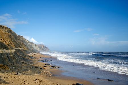 land slide: Charmouth beach rough sea and Golden Cap Dorset England