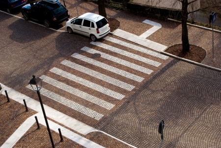 pedestrian crossing on the old cobbled stone street in Italy photo
