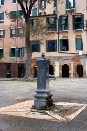 Venice old fountain with drinking water in the yard Stock Photo - 20221253