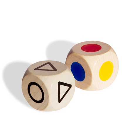 two wooden dice playing with symbols photo