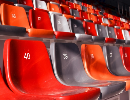row of empty stadium seats colored photo