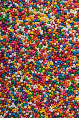 Background of colorful sprinkles, jimmies for cake decoration or icecream topping