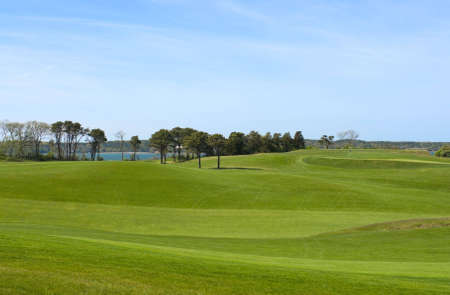 country club: Fairway at golf course, country club with manicured lawn, overlooking ocean Stock Photo