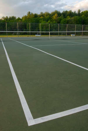 wideangle: Empty tennis court, net and lines, wideangle from corner Stock Photo