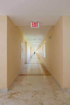Emergency exit sign in hotel hallway
