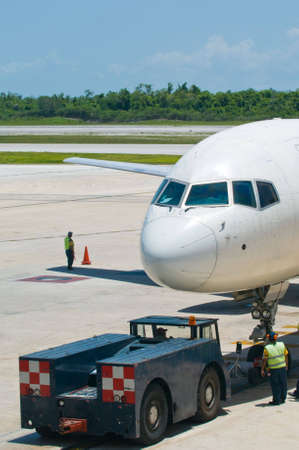 pushed: Airplane being pushed away from airport gate