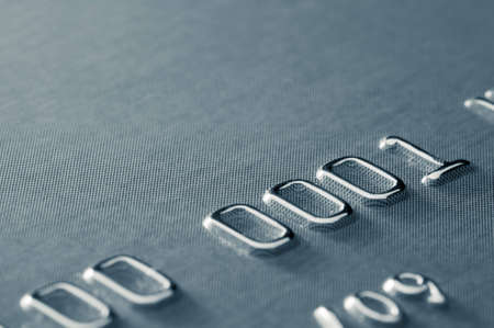 Extreme close-up of partial credit card number, selective focus, very shallow DOF photo