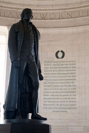 Statue of Thomas Jefferson inside memorial in Washington DC, with passage from the Declaration of Independence in background