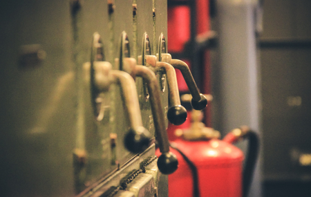Ancient levers on a control panel machine in a factory Stock Photo