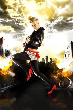Rock-Punk Girl With Electric Guitar On An Explosive Background photo