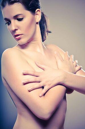 Sensual Portrait Of A Beutiful WomanSensual Portrait Of A Beutiful Woman Covering Her Breasts Stock Photo