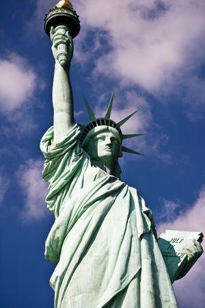 Statue Of Liberty On A Blue Clowdy Sky