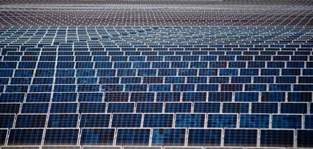 An Image Of Multiple Lineup Solar Panels Stock Photo