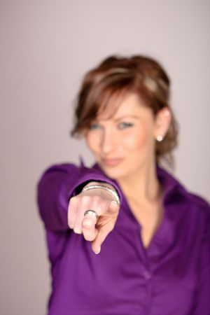 Focused Photo Of A Beautiful Woman Pointing With Finger photo