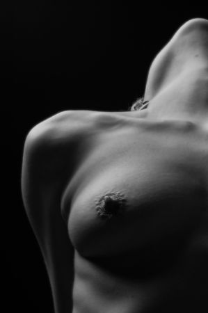 Closeup Photo Of A Womans Chest In Monotone