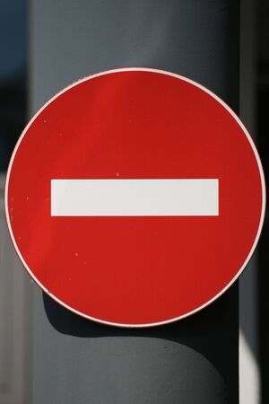 Photo Of A Forbidden Traffic Sign On Street Pillar photo