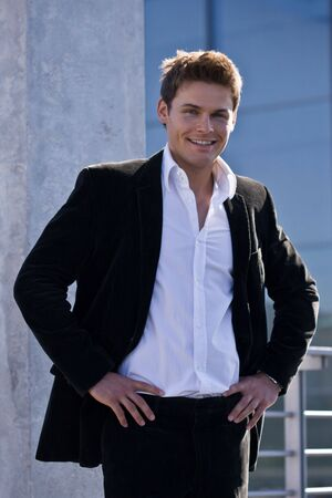 Photo Of A Young Handsome Man In A Corporate Attire Standing Standard-Bild
