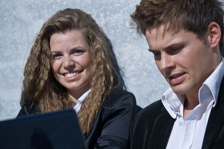 Closeup Of A Corporate Man And Woman With Laptop