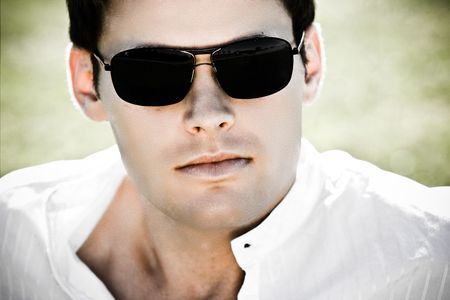 Contrast Closeup Of An Attractive Man With Sunglasses