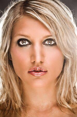 Front Closeup Portrait Of A Sensual Blond Woman