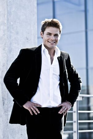 Young Attractive Man Standing In A Corporate Attire Stock Photo