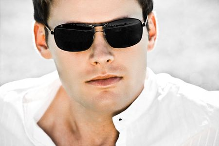 Closeup Of An Attractive Man With Black Sunglasses
