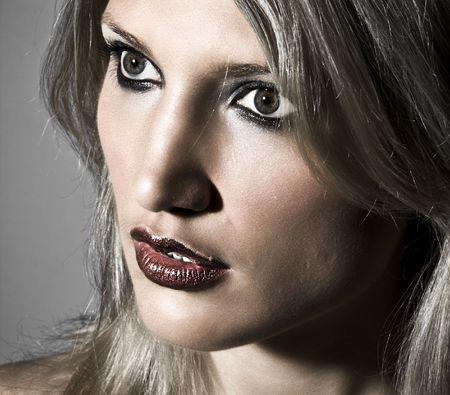 Closeup Side Portrait Of A Sensual Blond Woman