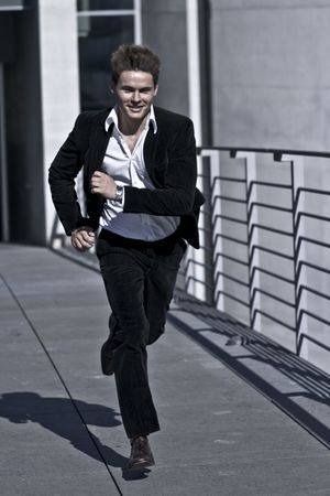 Young Attractive Man Running in A corporate Attire