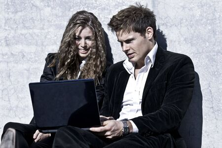 Photo Of A Young Corporate Couple With Laptop photo